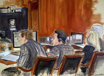 In this courtroom sketch, defendant Mehmet Hakan Atilla, center, listens to proceedings from the defense table, Nov. 28, 2017, in New York. Prosecutors claim that Atilla laundered Iranian oil money in violation of U.S. economic sanctions.