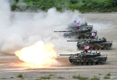 In this photo provided by the South Korean Defense Ministry, a South Korean marine K1 tank fires during a joint military exercise between South Korea and the United States in Pohang, South Korea, July 6, 2016.