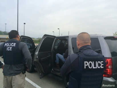 Officers from U.S. Immigration and Customs Enforcement's (ICE)  are shown during an operation targeting criminal aliens and other immigration violators in Philadelphia, May 11, 2016.