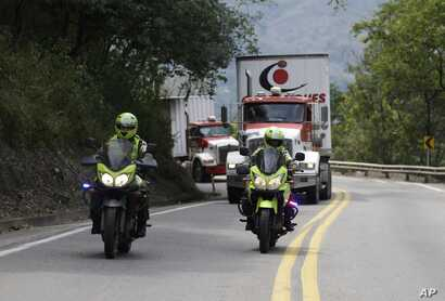Two semi-trailer trucks containing humanitarian aid from the U.S for Venezuela are escorted by Colombian police in Los Patios, near Cucuta, Colombia, Feb. 7, 2019, about 18 miles from the Colombian-Venezuelan border.