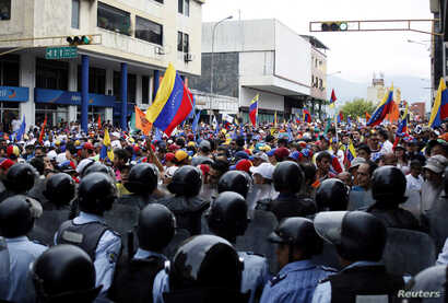 Opposition supporters clash with police during protests against unpopular leftist President Nicolas Maduro in San Cristobal, Venezuela, April 19, 2017.