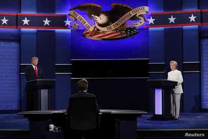 Republican U.S. presidential nominee Donald Trump and Democratic nominee Hillary Clinton begin their third and final 2016 presidential campaign debate at UNLV in Las Vegas, Nevada, Oct. 19, 2016.