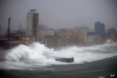 Strong waves brought by Hurricane Irma hit the Malecon seawall in Havana, Cuba, late Saturday, Sept. 9, 2017.