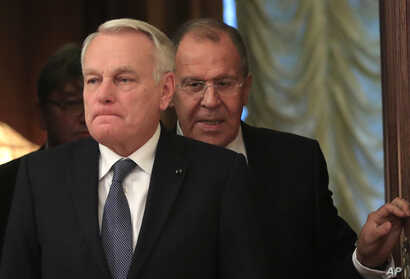 Russian Foreign Minister Sergey Lavrov, right, meets with French Foreign Affairs Minister Jean-Marc Ayrault  in Moscow, Russia, on October 6, 2016.