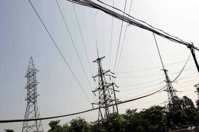 FILE - Power lines are seen in Ninh Binh Power Plant, which is a coal fired power plant to supply electricity, in Ninh Binh Province in Vietnam, Sept. 19, 2007.