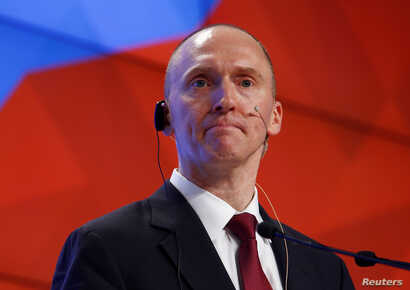 FILE - One-time advisor of U.S. president-elect Donald Trump Carter Page addresses the audience during a presentation in Moscow, December 12, 2016.