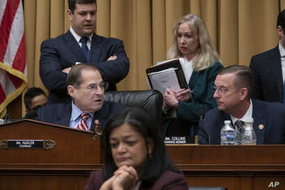 House Judiciary Committee Chair Jerrold Nadler, D-N.Y., joined at right by Ranking Member Doug Collins, R-Ga., passes a resolution to subpoena special counsel Robert Mueller's full report, on Capitol Hill in Washington, Wednesday, April 3, 2019.