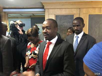 Nelson Chamisa, leader of of the Movement for Democratic Change Alliance (MDC), speaks to reporters in Harare, Zimbabwe, July 12, 2018. Chamisa is expected to meet with members of the Zimbabwe Electoral Commission over a presidential ballot paper whi...