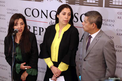 Lawmakers from the Popular Force Party (Partido Fuerza Popular) Alejandra Aramayo, Ursula Letona and Luis Galarreta speak to the media after Peru's President Martin Vizcarra asked the Congress for a new vote of confidence in his Cabinet in Lima, Peru...
