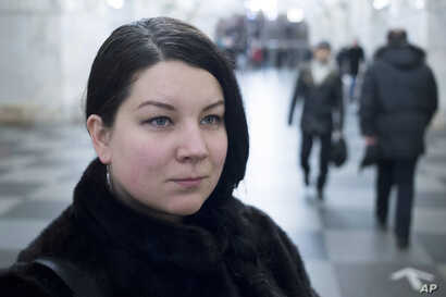 Journalist Ekaterina Vinokurova poses for a photo in the metro in Moscow, Russia, Dec. 20, 2017.
