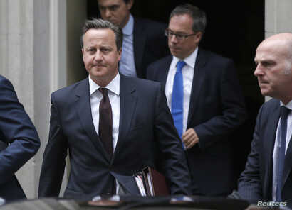 British Prime Minister, David Cameron leaves 10 Downing Street in London, Britain, Sept. 7, 2015.