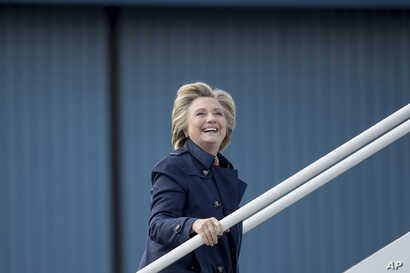 Campaign 2016 Clinton: Democratic presidential candidate Hillary Clinton boards her campaign plane in White Plains, N.Y., Tuesday, Oct. 4, 2016, to travel to Philadelphia.