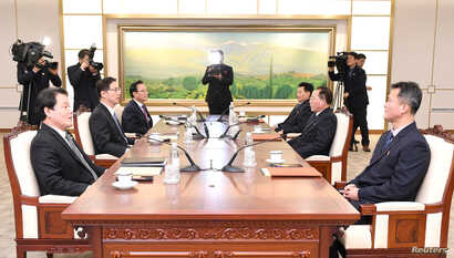 Head of North Korean delegation Jon Jong Su talks with his South Korean counterpart Chun Hae-sung during their meeting at the truce village of Panmunjom in the demilitarized zone separating the two Koreas, South Korea, Jan. 17, 2018.