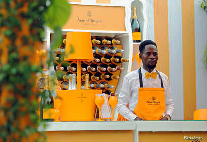 A bartender stands at a Veuve Clicquot champagne bar during the 2019 Lagos International Polo Tournament in Lagos, Nigeria, March 16, 2019.