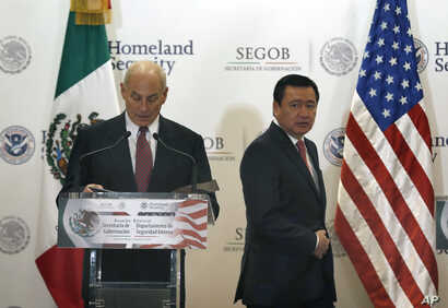 U.S. Homeland Security Secretary John Kelly, left, and Mexico's Interior Secretary Miguel Angel Osorio Chong arrive for a press conference in Mexico City, July 7, 2017.