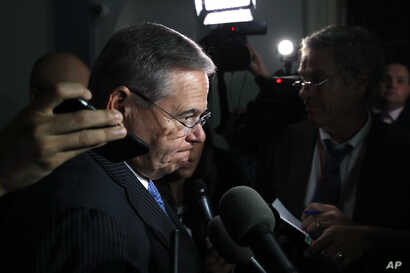 Sen. Bob Menendez, D-N.J., pauses while speaking to the media after attending a closed-door meeting of the Congressional Hispanic Caucus and Homeland Security Secretary Kirstjen Nielsen, July 25, 2018, on Capitol Hill in Washington.