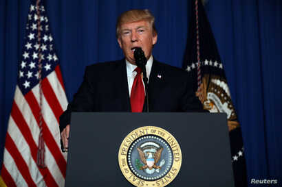 FILE - U.S. President Donald Trump delivers a statement about missile strikes on a Syrian airbase, at his Mar-a-Lago estate in West Palm Beach, Florida.