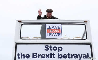 """Brexit campaigner Nigel Farage gestures during a """"Brexit Betrayal"""" march from Sunderland to London, in Sunderland, Britain, March 16, 2019."""