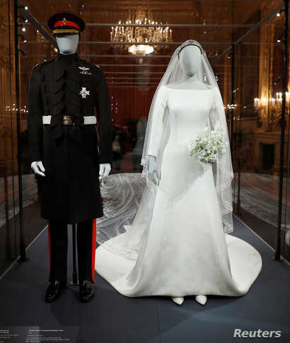 The wedding outfits of Meghan, Duchess of Sussex, and Harry, Duke of Sussex, are on display ahead of the exhibition A Royal Wedding, soon to open at Windsor Castle, in Windsor, Britain, Oct. 25, 2018.