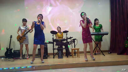 North Koreans singers perform at the Pyongyang A Ri Rang Restaurant in Bangkok, Thailand, Feb. 18, 2016. The Bangkok show was a half-hour of skilled performances and lightning-fast costume changes, from traditional hanboks to sparkly short dresses in...