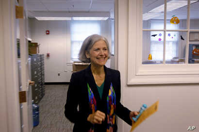 FILE - Ballot in hand, Green Party presidential candidate Jill Stein casts her ballot for U.S. president in Lexington, Mass., Oct. 26, 2012. The path for a third-party candidate contains a number of huge hurdles, the first being money.