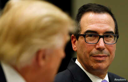 "US Treasury Secretary Steve Mnuchin (R) listens to US President Donald Trump speak during a 'strategic initiatives""'lunch at the White House in Washington, Feb. 22, 2017"