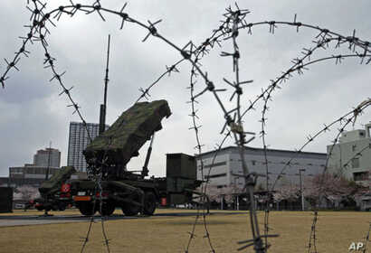 Patriot Advanced Capability-3 (PAC-3) land-to-air missiles are deployed at the Defense Ministry in Tokyo, April 7, 2012.
