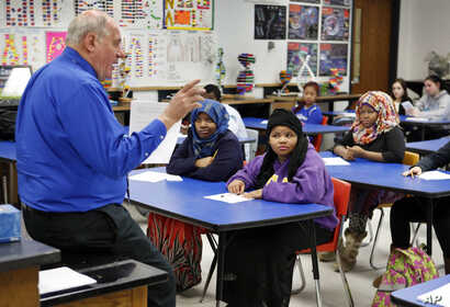 Mike McGraw teaches a biology class at Lewiston High School in Lewiston, Maine, Jan. 26, 2016. He is also the coach of the varsity soccer team whose undefeated team featured players from Somalia, Kenya and Congo.