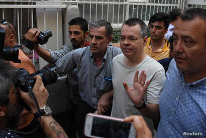 U.S. pastor Andrew Brunson reacts as he arrives at his home after being released from the prison in Izmir, Turkey, July 25, 2018.