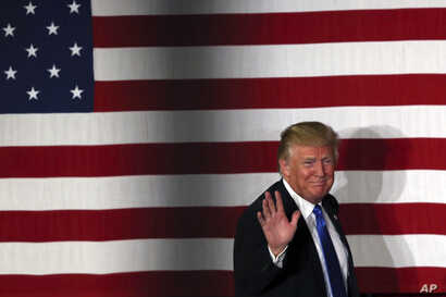 Republican presidential candidate, Donald Trump, waves during a campaign event in Lawrenceville, N.J., May 19, 2016.