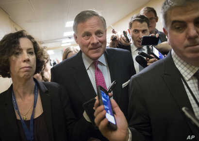 Reporters interview Senate Select Committee on Intelligence Chairman Sen. Richard Burr, R-N.C., the morning after President Donald Trump fired FBI Director James Comey, on Capitol Hill in Washington, May 10, 2017.