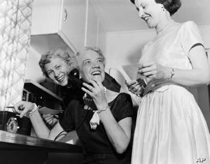 Sen. Margaret Chase Smith looks up while making calls to friends from her homein Skohegan, Maine in this June 21, 1954 file photo as returns of primary gave her a wide lead for Republican senatorial nomination. (AP file photo)