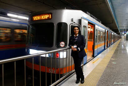 Serpil Cigdem, 44, an engine driver, poses for a photograph at Yenikapi station in Istanbul, Turkey, Feb. 24, 2017.