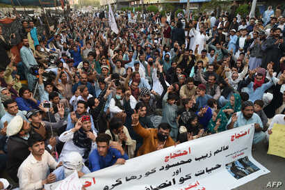 Pakistani activists of the Pashtun Tahaffuz Movement take part in a protest against the arrest of party leader in Karachi on Jan. 23, 2019.