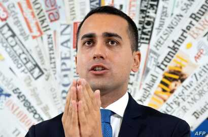 Italy Deputy Prime Minister and Labour, Industry Minister Luigi Di Maio gestures during a press conference, Nov. 9, 2018, in Rome.