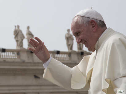 FILE - Pope Francis waves after his weekly general audience in St. Peter's Square at the Vatican, Sept. 9, 2015.
