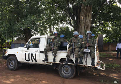 "United Nations Peacekeepers drive through  Yei, South Sudan, July 13, 2017. The United Nations peacekeeping mission's chief says Yei has ""gone through a nightmare."" Since fighting spread to the city a year ago, 70 percent of the population has fled. ..."