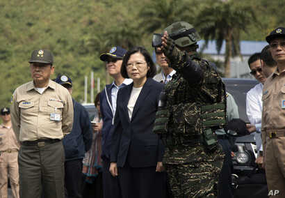 FILE - Taiwan's President Tsai Ing-wen, center, inspects at Su'ao naval station during a navy exercise in the northeastern port of Su'ao in Yilan County, Taiwan, Friday, April 13, 2018. Taiwan's government said Thursday that recent Chinese military d...