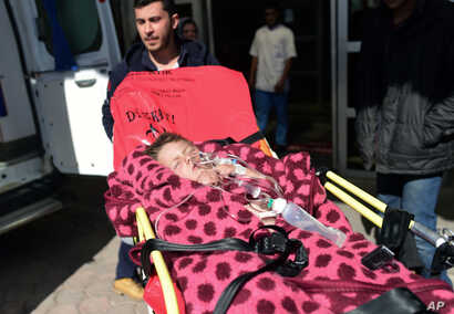 Turkish medics carry a wounded Syrian child to a hospital in Kilis, Turkey, Feb. 16, 2016.