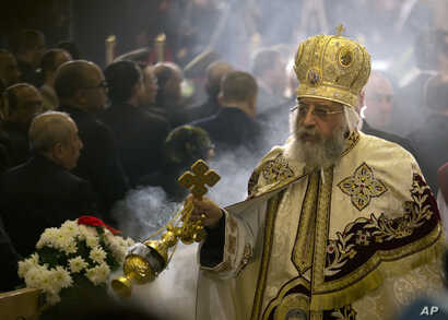 Coptic Pope Tawadros II leads Christmas Eve Mass at St. Mark's Cathedral, in Cairo, Egypt, Jan. 6, 2017.
