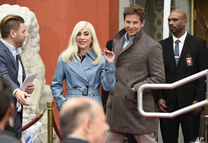 "Lady Gaga, left, and Bradley Cooper, co-star's in ""A Star Is Born,"" attend a hand and footprint ceremony honoring actor Sam Elliott at the TCL Chinese Theatre, Jan. 7, 2019, in Los Angeles."