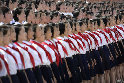 A North Korean student choir sing as part of the celebrations for the anniversary of the Korean War armistice agreement, July 27, 2014, in Pyongyang, North Korea.