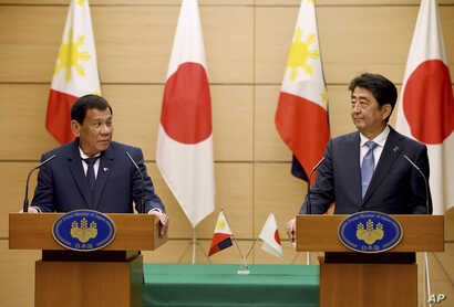 Philippine President Rodrigo Duterte, left, and Japanese Prime Minister Shinzo Abe at a joint press conference at Abe's official residence in Tokyo, Oct. 30, 2017. Duterte won pledges from Japan of help with fighting terrorism and assistance in build...