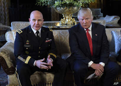 President Donald Trump, right, listens as Army Lt. Gen. H.R. McMaster, now the presidents new new national security adviser, left, talks at Trump's Mar-a-Lago estate in Palm Beach, Fla, Feb. 20, 2017.