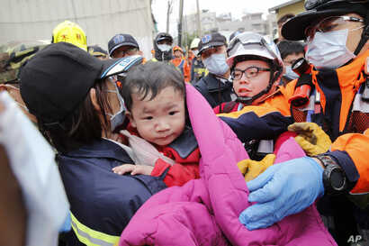 A baby boy is rescued from a collapsed building after an earthquake in Tainan, Taiwan, Feb. 6, 2016.