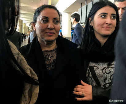 An Iraqi woman, Iman Alknfosche, is embraced by her daughter Elaf Hussain after she was released by ICE after arriving at John F. Kennedy International Airport, New York, Jan. 29, 2017. Alknfosche was held for about 30 hours.