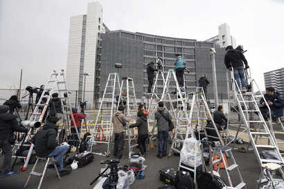 Step ladders placed by photographers and cameramen are seen in front of Tokyo Detention Center, where former Nissan Chairman Carlos Ghosn was detained, March 6, 2019, in Tokyo.