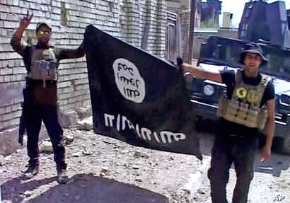 This image made from Associated Press video shows, Iraqi troops turn the Islamic State flag upside down in Fallujah, Iraq, Sunday, June 26, 2016.