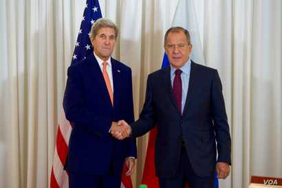 U.S. Secretary of State John Kerry shakes hands with Russian Foreign Minister Sergey Lavrov before a bilateral meeting on August 26, 2016, at the President Wilson Hotel in Geneva, Switzerland.