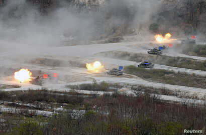 FILE - South Korean Army K1A1 and U.S. Army M1A2 tanks fire live rounds during a U.S.-South Korea joint live-fire military exercise, at a training field, near the demilitarized zone, separating the two Koreas in Pocheon, South Korea April 21, 2017. P...